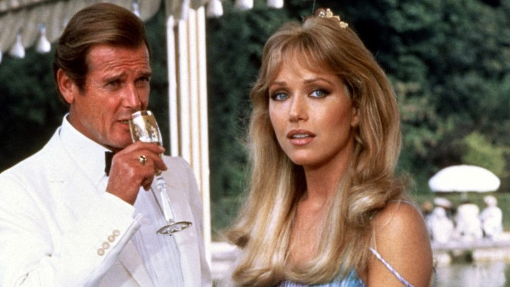 Roger Moore sips champagne beside Tanya Roberts