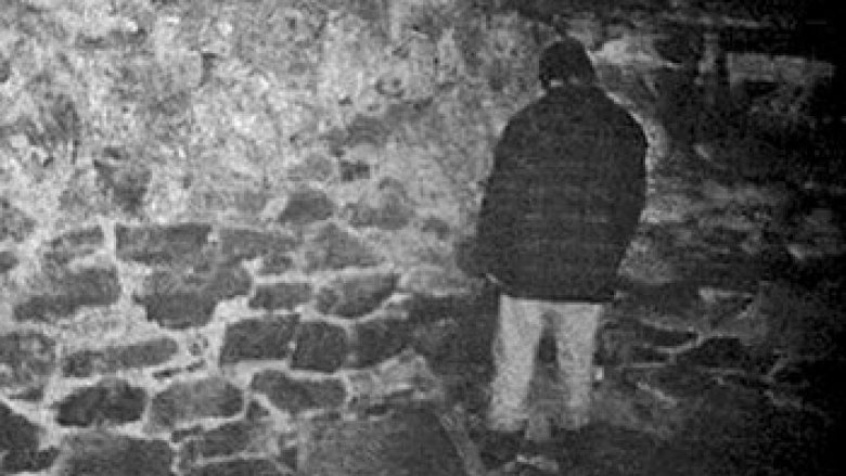 Mike Williams standing in a corner in the basement facing away
