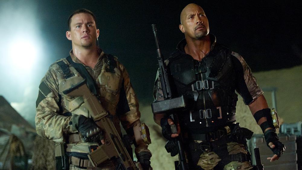 Tatum and Johnson with guns