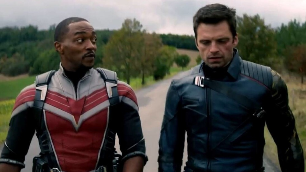 Sam and Bucky walk down a road