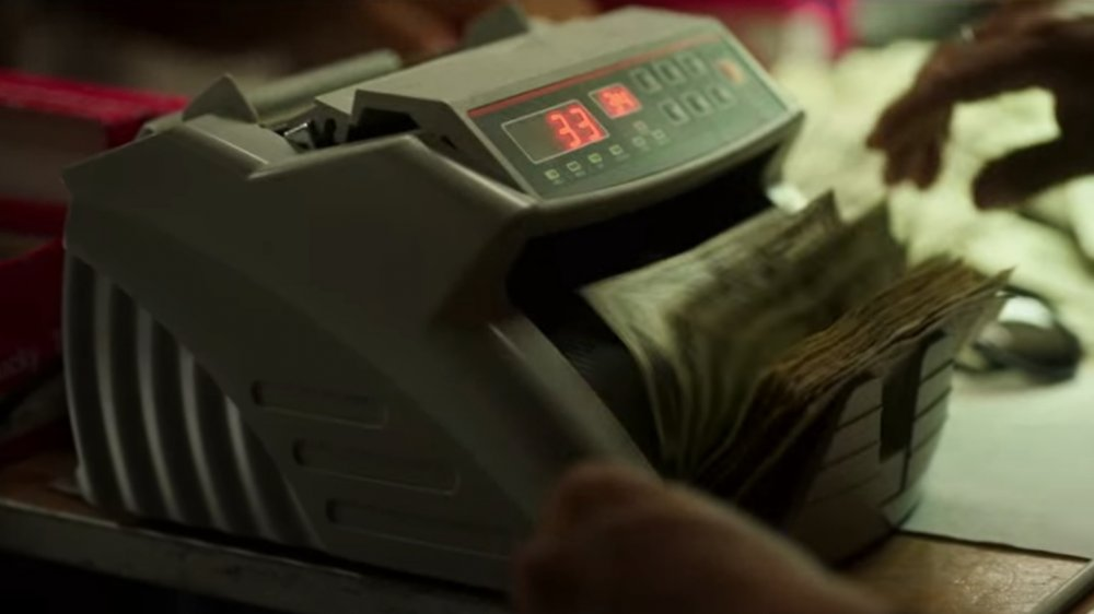 Money being counted in the Byrde's casino on Ozark