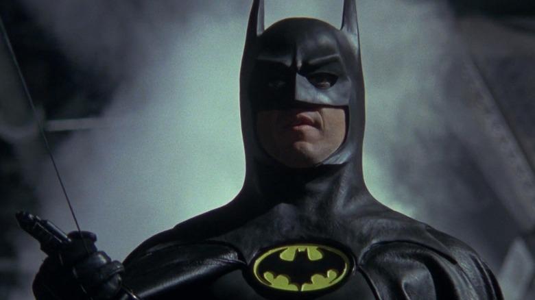 Batman holding grappling gun