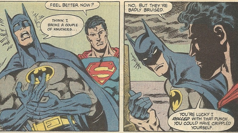 Batman recovering after punching Superman