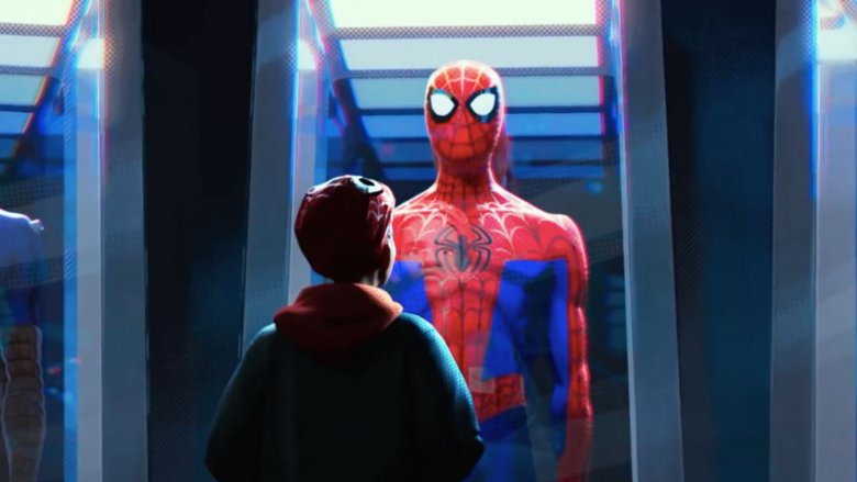Miles Morales looking at one of the costumes of the deceased Peter Parker