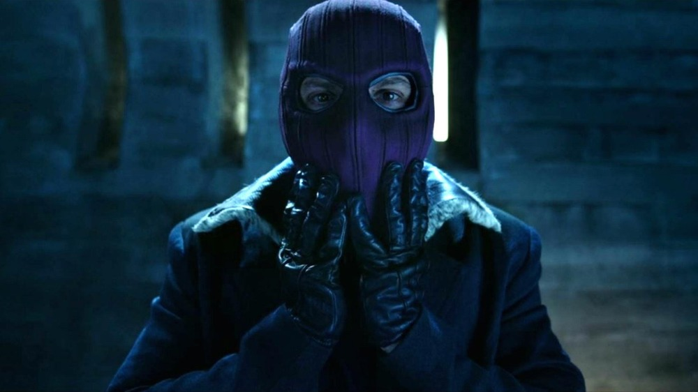 Zemo donning his mask