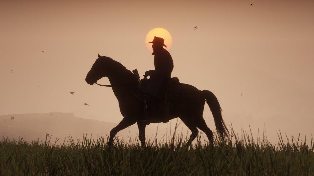 Arthur Morgan rides during the sunset
