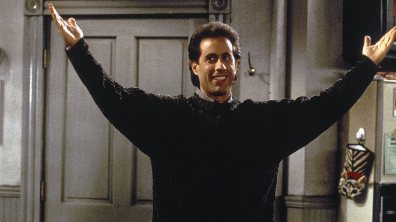 Seinfeld arms outstretched