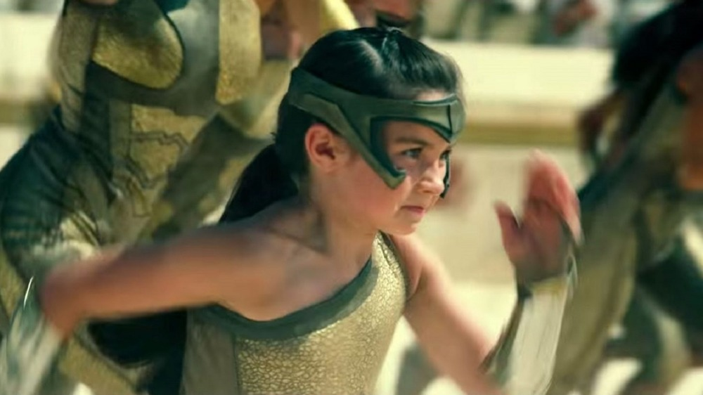 Young Diana Prince running