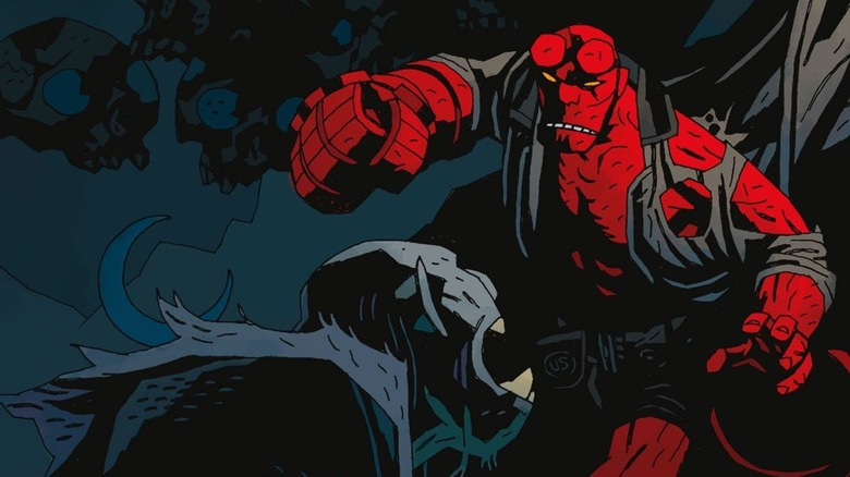 Hellboy about to punch a vampire