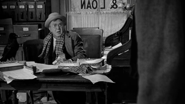 Thomas Mitchell as Uncle Billy with his raven in It's a Wonderful Life