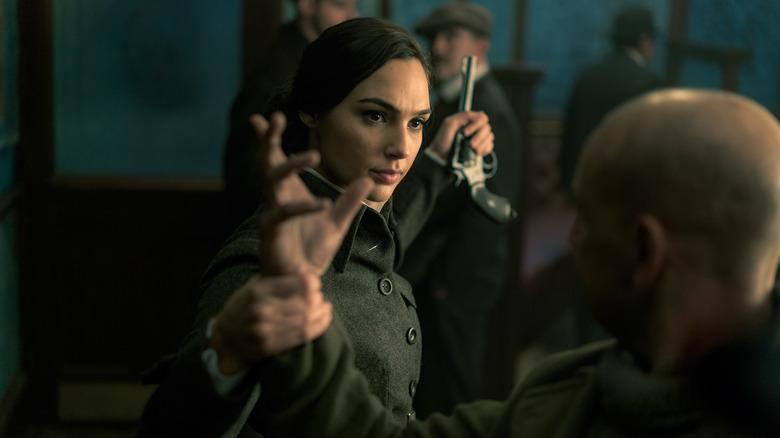 Wonder Woman, Gal Gadot holding a gun