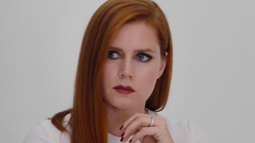 Amy Adams looks off-screen nervously